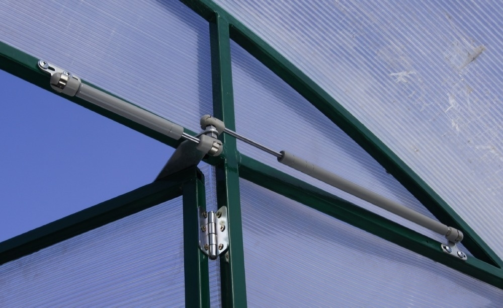 автоматическое открывание дверей в теплице термопривод